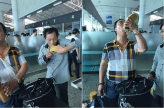Hành khách uống cạn rượu tráng dương trước khi lên máy bay